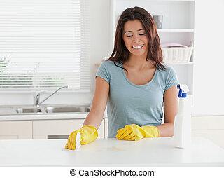 Beautiful woman doing the housework