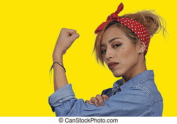 Rosie the Riveter - Beautiful woman dressed as the iconic...