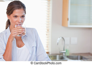 Beautiful woman drinking a glass of water