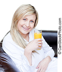 Beautiful woman drinking an orange jus