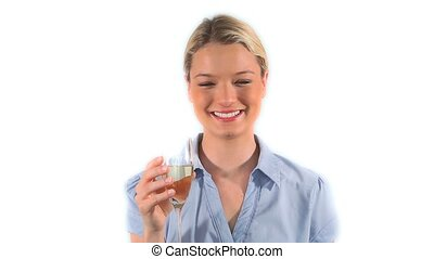 Beautiful woman drinking champagne against white background