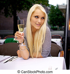 Beautiful woman drinking champagne