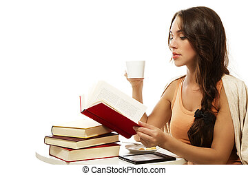 beautiful woman drinking coffee while reading book on white background