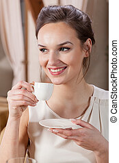 Beautiful woman drinking espresso
