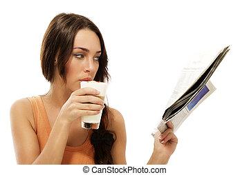 beautiful woman drinking latte macchiato coffee reading newspaper on white background
