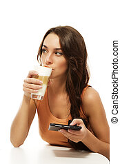 beautiful woman drinking latte macchiato holding ebook reader on white background
