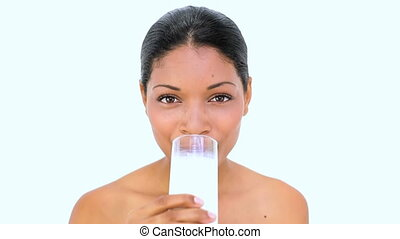 Beautiful woman drinking milk on white background