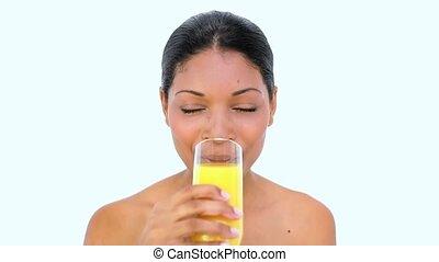 Beautiful woman drinking orange juice on white background