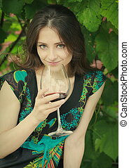 Beautiful woman drinking red wine outdoor summer background