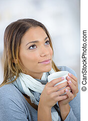 beautiful woman drinking the cup of tea