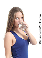Beautiful woman drinking water from a glass