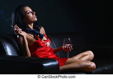 beautiful woman drinkink wine and smoke sigarrets
