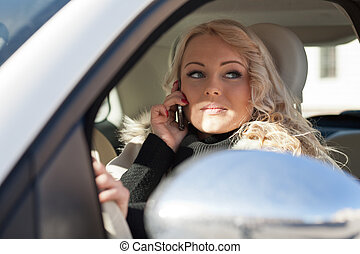 beautiful woman driving and phoning