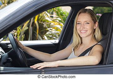 beautiful woman driving car at sunset