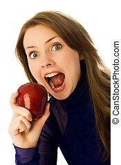 beautiful woman eating an apple