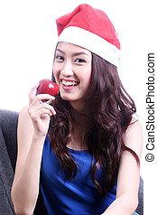 Beautiful woman eating apple