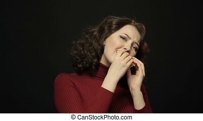 Beautiful woman eating hamburger, closeup shooting