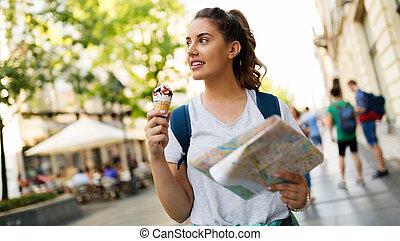 Beautiful woman eating ice cream outdoors