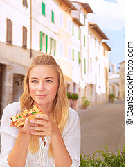 Beautiful woman eating pizza