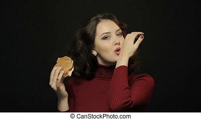 Beautiful woman eating sandwich, closeup shooting