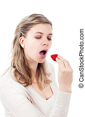 Beautiful woman eating strawberry