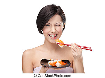 Beautiful woman eating sushi - Black-haired girl eating ...