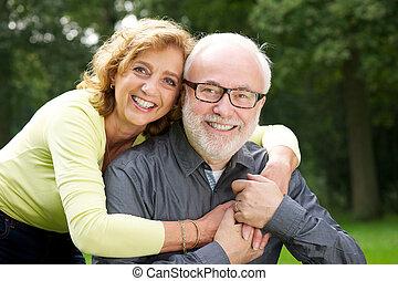Beautiful woman embracing handsome man