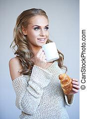 Beautiful woman enjoying a coffee break