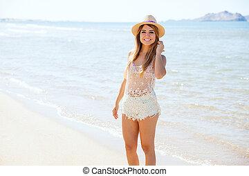 Beautiful woman enjoying a day at the beach