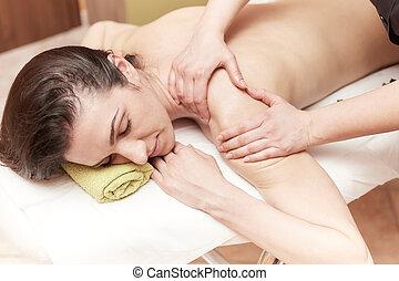 Beautiful woman enjoying a massage therapy
