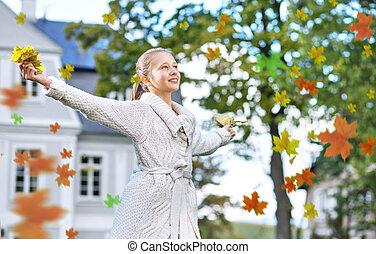 Beautiful woman enjoying an autumn
