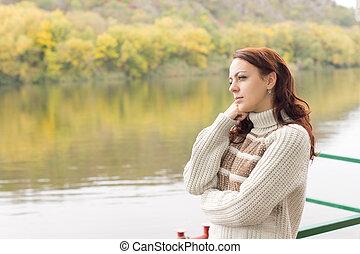 Beautiful woman enjoying autumn scenery
