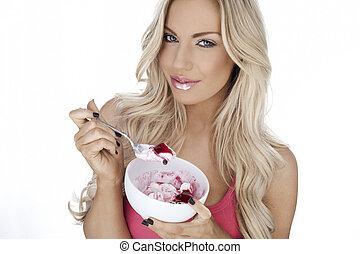 Beautiful woman enjoying dessert