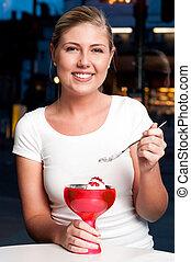 Beautiful woman enjoying tempting dessert