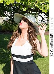 Beautiful woman enjoying the sun in the park