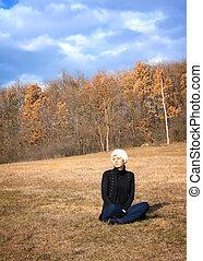 beautiful woman enjoying the warm autumn sun