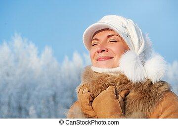 Beautiful woman enjoying winter day