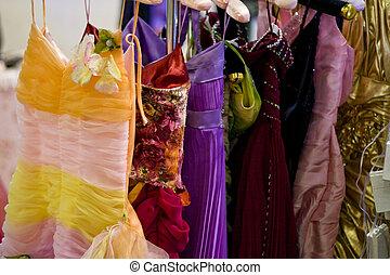 Beautiful woman evening dress in the rack