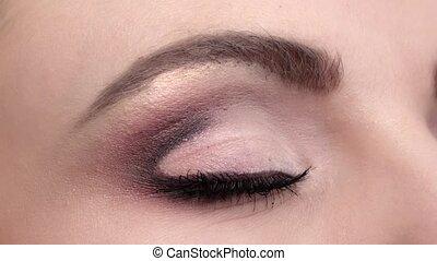 Beautiful woman eye blue eyes looking up. Closeup -...