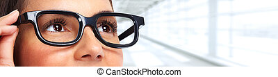 Beautiful woman eyes with eyeglasses.