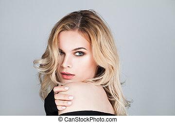 Beautiful Woman Face. Cute Girl with Blonde Hair