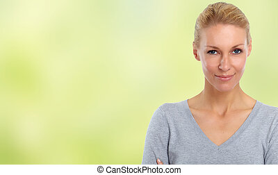 Beautiful woman face over green abstract background.