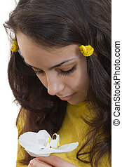 Beautiful woman face with a flower