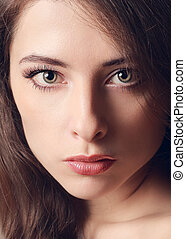 Beautiful woman face with green eyes. Vintage closeup ...