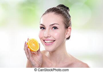 Beautiful woman face with orange