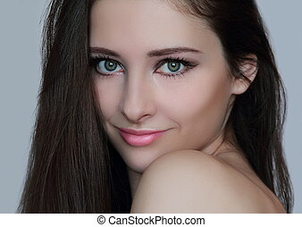 Beautiful woman face with perfect evening makeup looking sexy. Closeup isolated portrait of romantic long hair brunette girl