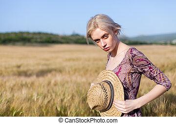 beautiful woman farmer in field of wheat farm