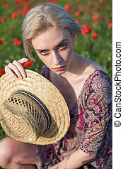beautiful woman farmer's field with red flowers collection