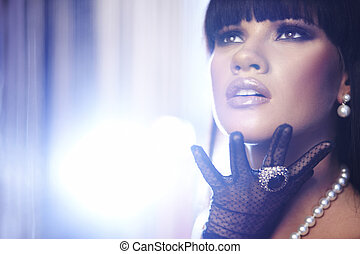 Beautiful woman. Fashion art photo. Close-up makeup