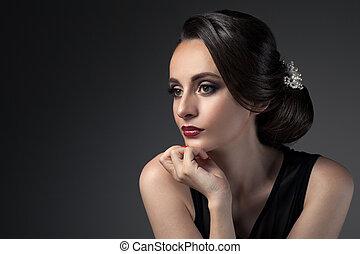 Beautiful Woman. Fashion Festive Coiffure with Pearls....